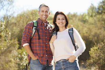 Couple hiking & smiling l dentist garland