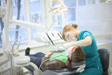 dental patient receiving dental exam l general dentist garland tx