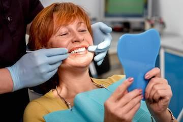 Woman sitting in dental exam chair l dentist garland